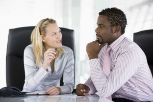 Two businesspeople in office talking