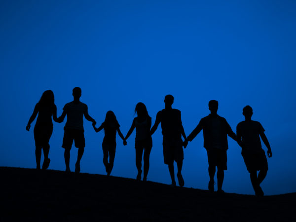 Silhouette of a line of people holding
