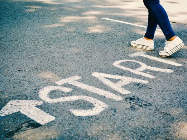 Feet of women with start word on road concept keep going ,hipster tone